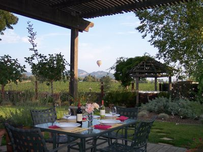 Enjoy acres of vineyard views and hot air balloons from the backyard deck.