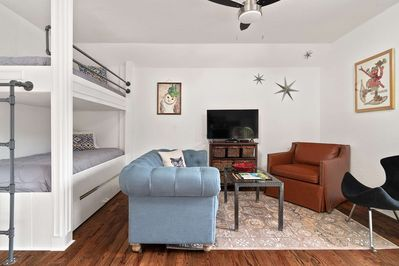 Come on in! This lovingly-updated rental has been wrapped in a classic, cozy-chic style!