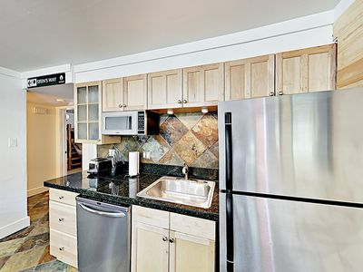 Kitchen - Channel your inner chef in the gourmet kitchen, outfitted with granite countertops, designer stainless steel appliances, and stone tile.
