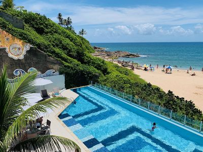 Photo for BEACHFRONT IN RIO VERMELHO - DIRECT ACCESS TO THE BEACH