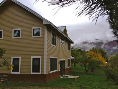 Photo for New home with mountain views, large orchard yard, and sitting porch.