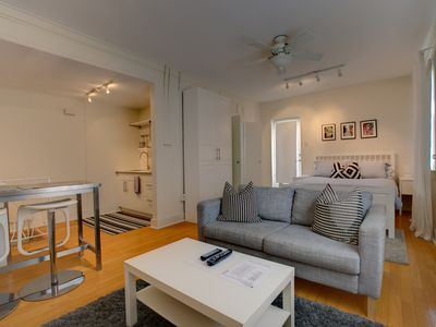 Photo for Beautifully renovated apartment with a private roof top deck