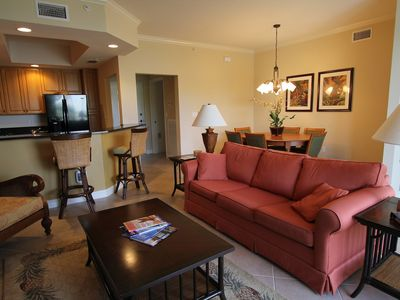 Photo for Tropical Comfort - Corner end condo with views of gorgeous resort pool!