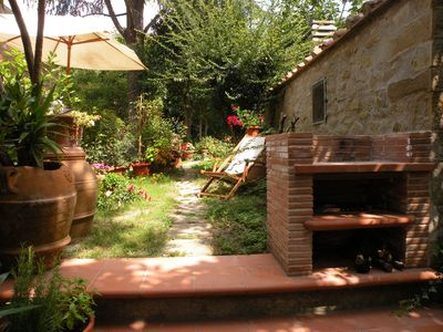 Photo for Charming apt Cortona with private garden, barbeque, Wi-fi, air conditioning