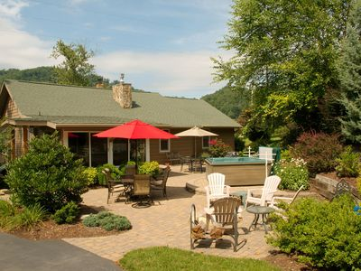 The beautifully landscaped patio to enjoy the fire pit, hot tub & dining outside