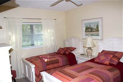 New twin beds in guest room. King Bed upon request