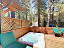 Back Deck - Sink into a private hot tub on the sun-drenched back deck.