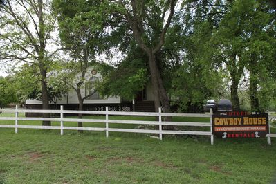 Cowboy House is easy to recognize, just off of FM 1050 near Utopia