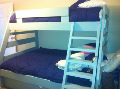 Bunk beds Twin on top Double bottom Twin trundle Also a crib in this room