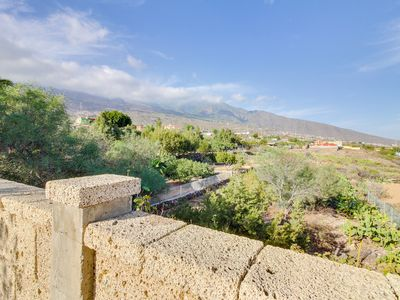Photo for Hillside villa with private swimming pool, breathtaking mountain & ocean views!