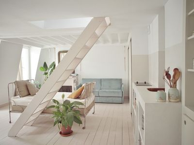 Photo for Summer light: architect's nest between rooftops