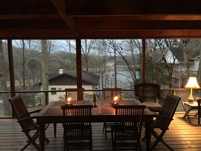 Evening dining on screen porch with lake view