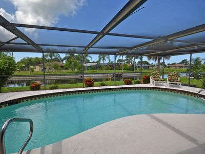 Photo for 3 Bedroom/2 Bath house with heated pool, canal with dock, 15 minutes to beaches