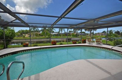 Heated pool with water view of the best canal in Rotonda West