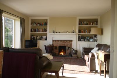 Sitting room with open fire, books, CD, DVDS, games, local info etc