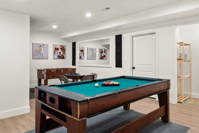 Game Room with pool, air hockey, foosball, and board games