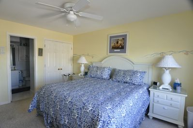 Master bedroom with en suite bath, with a water view