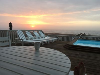 Sunrise on the deck with a hot coffee is waiting for you.