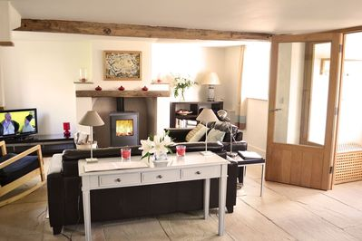 Ground floor: Sitting area in the spacious living space with wood burner