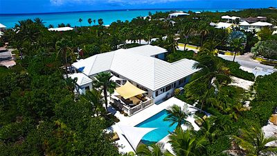 Photo for 10 steps from Grace Bay beach, newly renovated, 9 bedroom house, sleeps 20