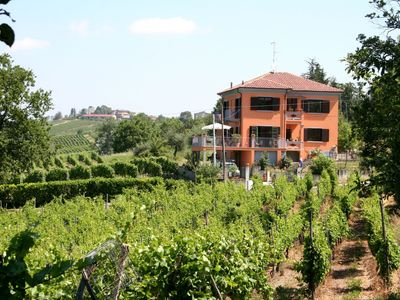 Photo for Apartment in three-family villa surrounded by vineyards, with garden and pool