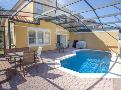 Photo for Updated, modern 4BR/3BR private pool TH steps to clubhouse, 5 miles to WDW.