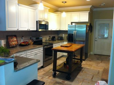 Kitchen with island and bar