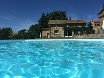 Photo for Stone house with heated pool and large wooded grounds WIFI