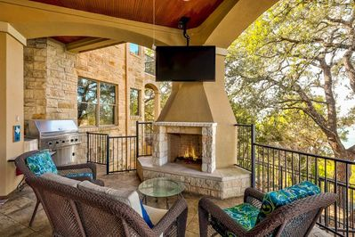 """Outdoor Kitchen - Fire up the grill, light a fire, or watch a show on the 65"""" TV on the patio."""