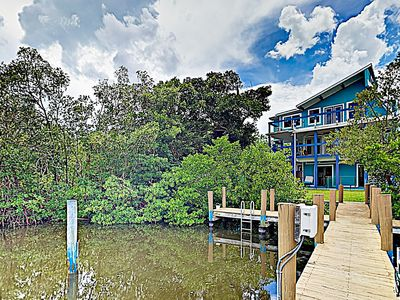 Photo for New Listing! Stylish Beach House w/ Lovely Canal Views, Huge Deck, Boat Dock