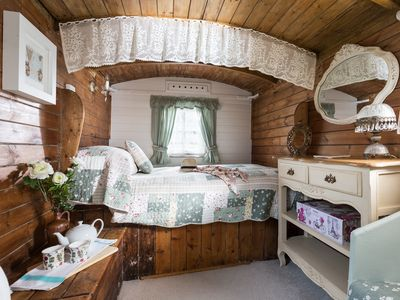 Photo for Quirky home with romantic shepherds' hut bedrooms and pretty garden near Padstow