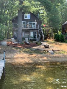 Lake Winnisquam home with beach and private boat dock. 15 minutes to Gunstock.