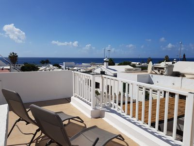 Photo for Sea view apartment with roof terrace, central Puerto del Carmen, 2 mins to beach