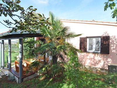 Photo for Wonderful holiday home with air conditioning, WiFi, terrace and barbecue area
