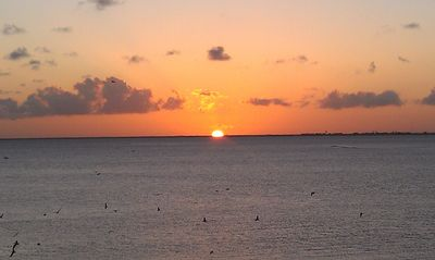 Enjoy sunset from covered porches or pier.  This is Spring  to October sunsets.