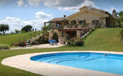 Photo for Villa with private pool surrounded by the green of Lake Bracciano