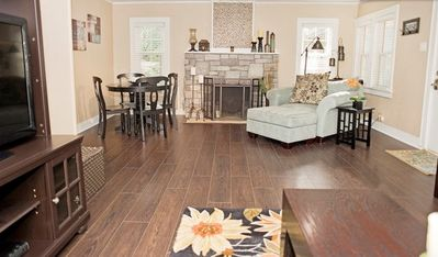 Dining table and sitting chair off the living room with COZY rock fireplace