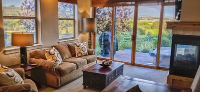 Photo for Sleeps 8 Town home w/ private hot tub, next to restaurants, shops, and Canyons!!