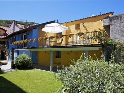 Photo for Charming 2½-room house with an idyllic garden in the old town of Cannobio