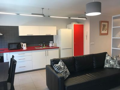 Open plan living/dining/kitchen with air conditioning.