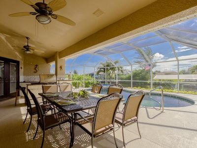 Photo for Morning Sun 4 bedroom/2 baths gulf access home upscale,outside kitchen, pool and Jacuzzi, 4 bikes