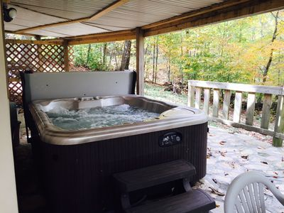 5 person (can fit 6) hot tub (covered) on bottom deck.