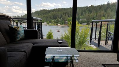 From the living room, you can gaze at the river as if you're sitting outside.