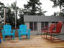 Deck with plenty of space for relaxing  and outdoor dining.