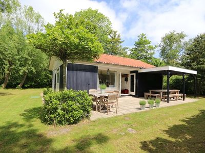 Photo for Het Ongerepte 15-18 wooden chalet with privacy near beach