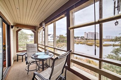Soak in the marsh views from this vacation rental condo's wraparound deck!