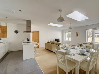 Photo for This stunning contemporary apartment is just a few minutes' walk from the fabulous sandy beach in th