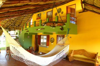 view of the social area, 2 bedrooms upstairs. Hammocks to take that deserved nap