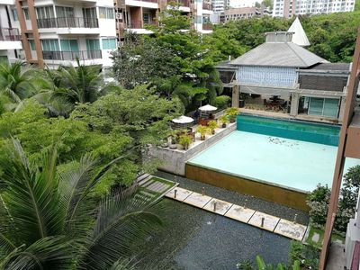 Photo for Tropical Pool Garden Condo Downtown Pattaya, Bus to walking street