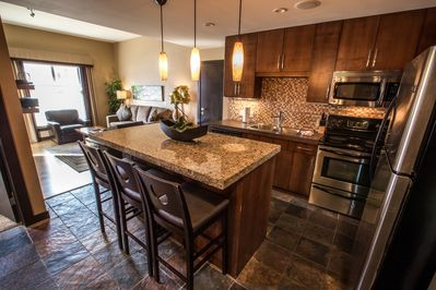 This beautiful unit features a modern, gourmet kitchen and lots of natural light